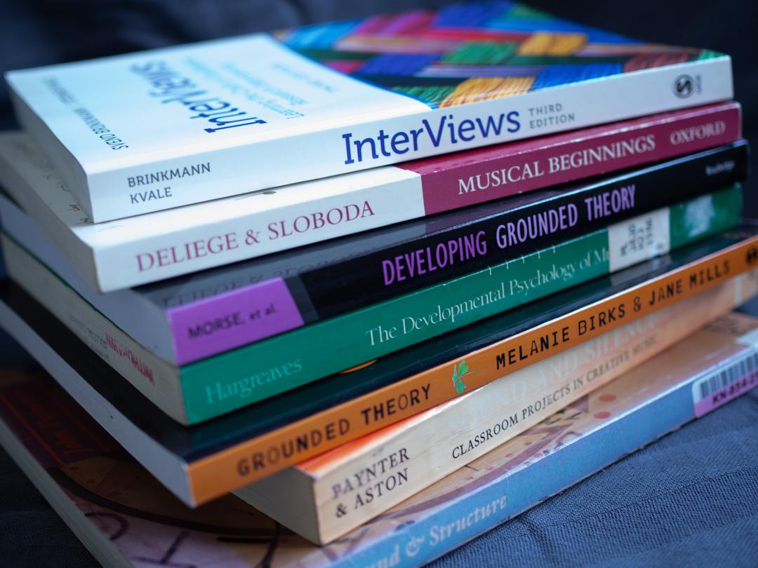 A pile of PhD books